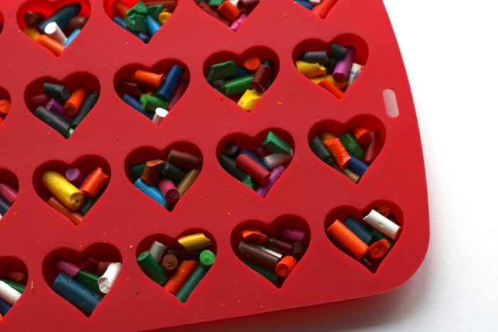 Repurpose old crayons to make a cute non-candy DIY project Microwave Melted Crayon Hearts for Valentine's Day!