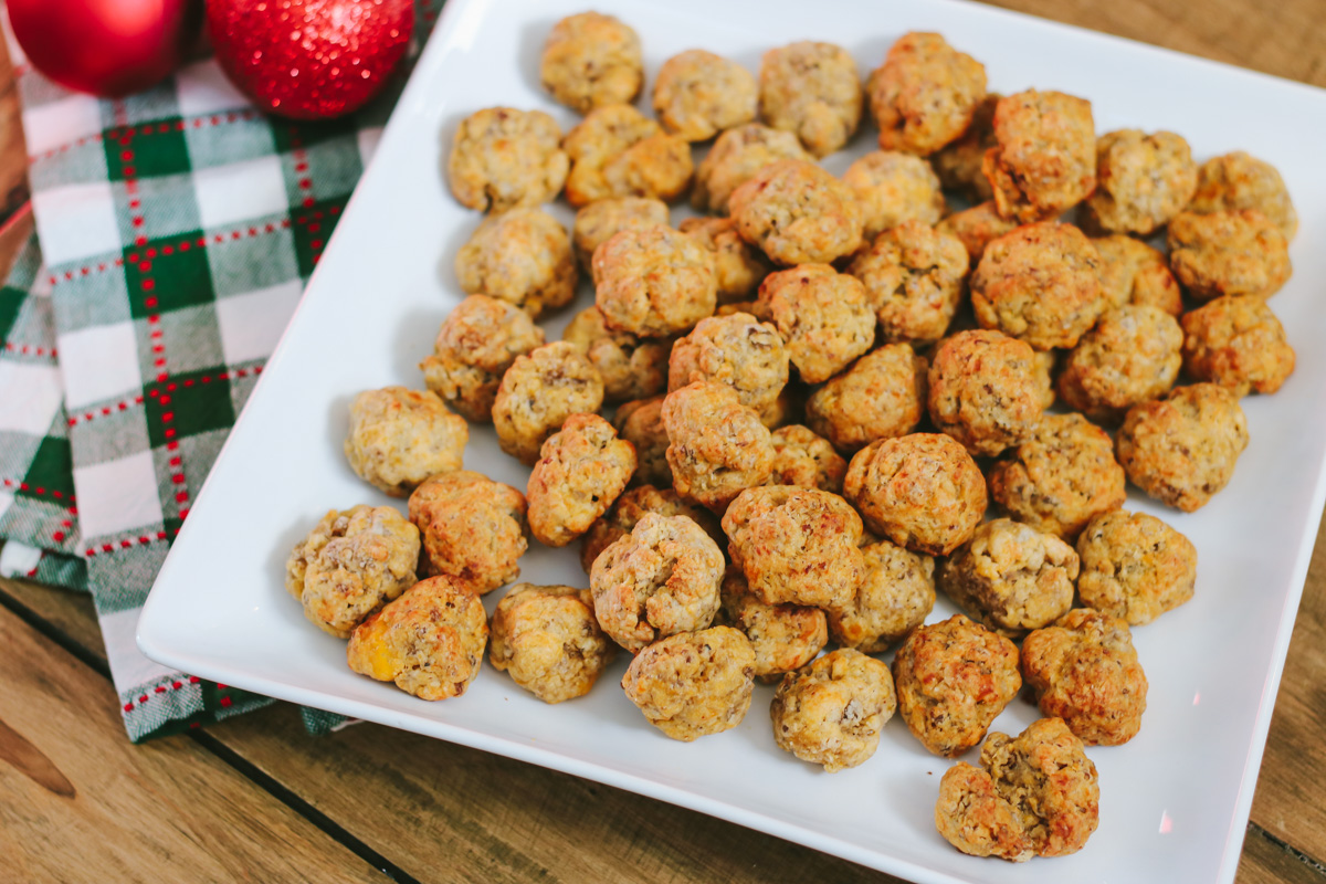 My sausage balls recipe made with Bisquick, pork sausage and cheddar is a favorite holiday appetizer and a big hit with guests. They continue to be one of my most-requested holiday recipes! Serve sausage balls at your next holiday party.