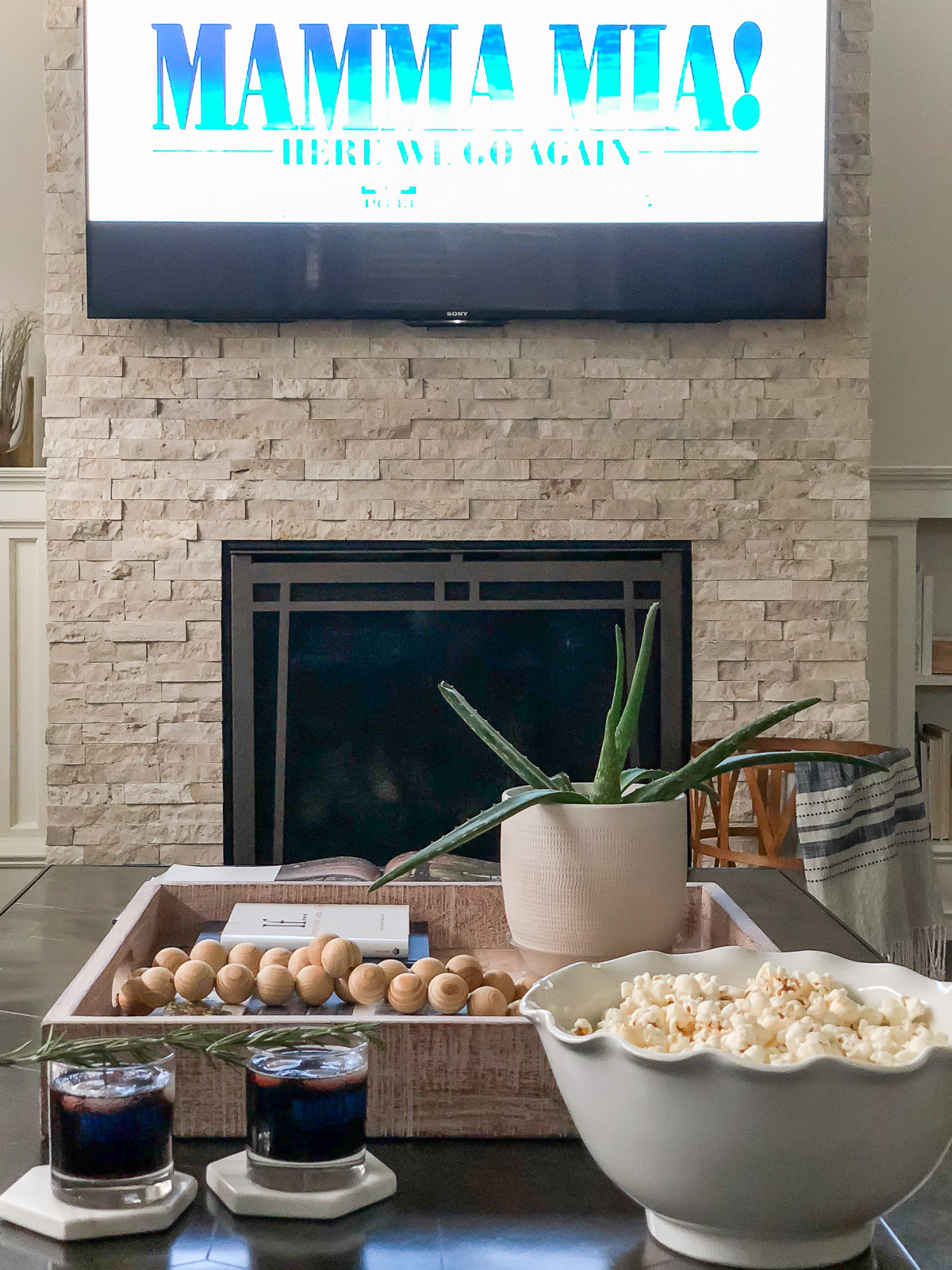 What better way to celebrate than to plan a Mamma Mia! Movie Night In with a healthy Greek inspired menu {AIP, Paleo, Whole 30} that's easy to prepare!